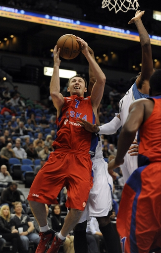 Oct 7, 2013; Minneapolis, MN, USA;  CSKA Moscow guard Vitaly Fridzon (7) is fouled on a shot in the second quarter against the Minnesota Timberwolves at Target Center. Mandatory Credit: Marilyn Indahl-USA TODAY Sports