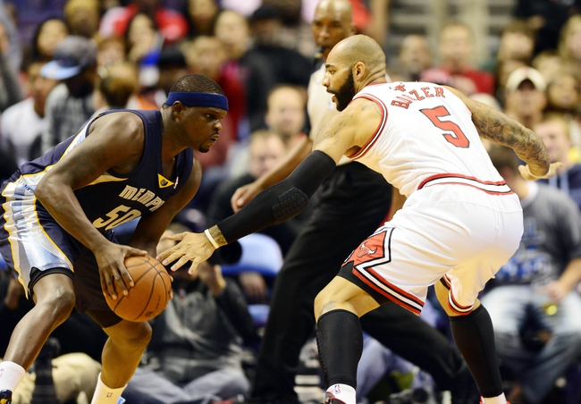 Oct 7, 2013; St. Louis, MO, USA; Memphis Grizzlies power forward Zach Randolph (50) handles the ball as Chicago Bulls power forward Carlos Boozer (5) defends during the first quarter at Scottrade Center. Mandatory Credit: Jeff Curry-USA TODAY Sports