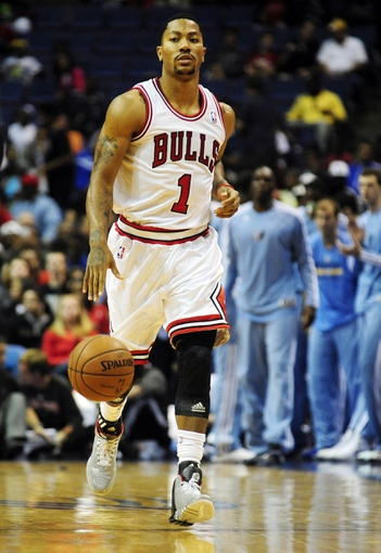 Oct 7, 2013; St. Louis, MO, USA; Chicago Bulls point guard Derrick Rose (1) handles the ball against the Memphis Grizzlies during the first quarter at Scottrade Center. Mandatory Credit: Jeff Curry-USA TODAY Sports