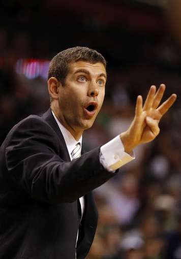 Oct 7, 2013; Boston, MA, USA; Boston Celtics head coach Brad Stevens reacts as they take on the Toronto Raptors in the second half at TD Garden. The Raptors defeated the Celtics 97-89. Mandatory Credit: David Butler II-USA TODAY Sports