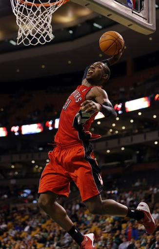 Oct 7, 2013; Boston, MA, USA; Toronto Raptors shooting guard Terrence Ross (31) drives the ball to the basket against the Boston Celtics in the second half at TD Garden. The Raptors defeated the Celtics 97-89. Mandatory Credit: David Butler II-USA TODAY Sports