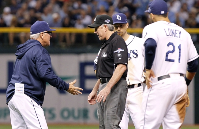 Oct 7, 2013; St. Petersburg, FL, USA; Tampa Bay Rays manager Joe Maddon (70) comes out and argues with the umpires after Boston Red Sox left fielder Quintin Berry (not pictured) was called safe on a stolen base attempt during the eighth inning of game three of the American League divisional series at Tropicana Field. Mandatory Credit: Kim Klement-USA TODAY Sports