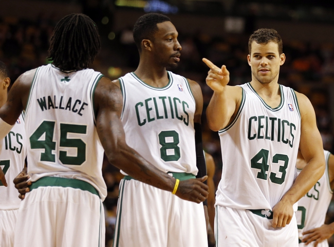 Oct 7, 2013; Boston, MA, USA; Boston Celtics forward Kris Humphries (43), forward Jeff Green (8) and forward Gerald Wallace (45) on the court against the Toronto Raptors in the second half at TD Garden. The Raptors defeated the Celtics 97-89. Mandatory Credit: David Butler II-USA TODAY Sports