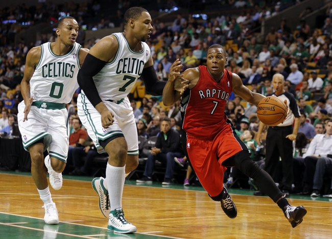 Oct 7, 2013; Boston, MA, USA; Toronto Raptors point guard Kyle Lowry (7) drives the ball against Boston Celtics forward Jared Sullinger (7) and guard Avery Bradley (0) in the second half at TD Garden. The Raptors defeated the Celtics 97-89. Mandatory Credit: David Butler II-USA TODAY Sports