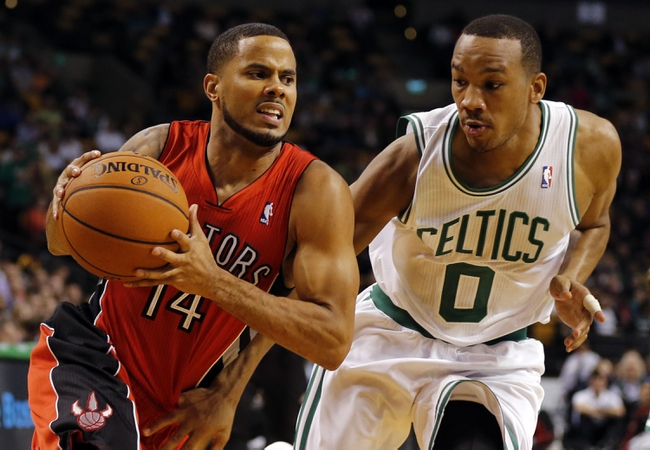 Oct 7, 2013; Boston, MA, USA; Toronto Raptors point guard D.J. Augustin (14) drives the ball against Boston Celtics guard Avery Bradley (0) in the second half at TD Garden. The Raptors defeated the Celtics 97-89. Mandatory Credit: David Butler II-USA TODAY Sports