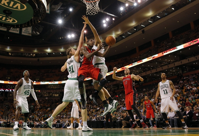 Oct 7, 2013; Boston, MA, USA; Toronto Raptors point guard Dwight Buycks (13) works the ball past Boston Celtics forward Kelly Olynyk (41) and center Vitor Faverani (38) in the second half at TD Garden. The Raptors defeated the Celtics 97-89. Mandatory Credit: David Butler II-USA TODAY Sports