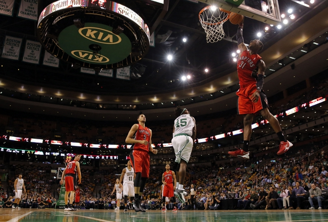 Oct 7, 2013; Boston, MA, USA; Toronto Raptors shooting guard Terrence Ross (31) drives the ball to the basket against Boston Celtics forward Gerald Wallace (45) in the second half at TD Garden. The Raptors defeated the Celtics 97-89. Mandatory Credit: David Butler II-USA TODAY Sports