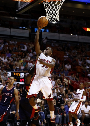 Oct 7, 2013; Miami, FL, USA;  Miami Heat point guard Norris Cole (30) drives to the basket against the Atlanta Hawks in the second half at American Airlines Arena. Mandatory Credit: Robert Mayer-USA TODAY Sports