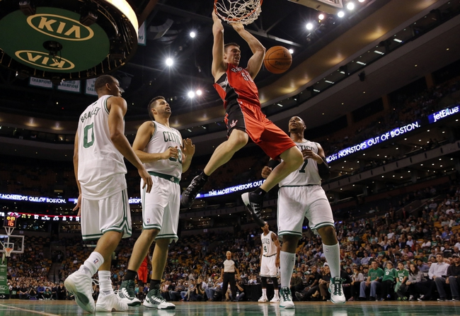Oct 7, 2013; Boston, MA, USA; Toronto Raptors power forward Tyler Hansbrough (50) makes the basket against `Boston Celtics center Vitor Faverani (38), forward Jared Sullinger (7) and guard Avery Bradley (0) in the second half at TD Garden. The Raptors defeated the Celtics 97-89. Mandatory Credit: David Butler II-USA TODAY Sports