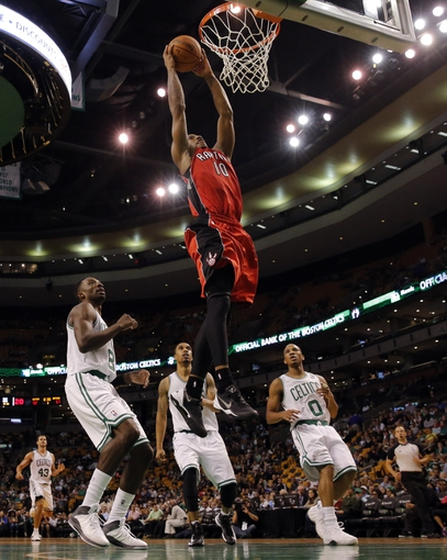Oct 7, 2013; Boston, MA, USA; Toronto Raptors shooting guard DeMar DeRozan (10) drives the ball to the basket past Boston Celtics forward Jeff Green (8) in the second half at TD Garden. The Raptors defeated the Celtics 97-89. Mandatory Credit: David Butler II-USA TODAY Sports