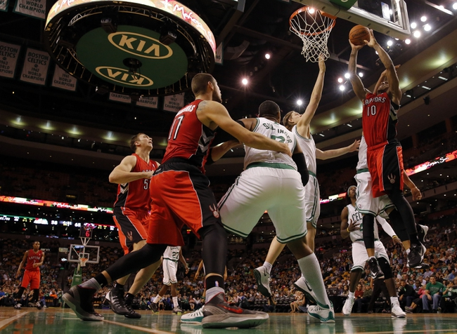 Oct 7, 2013; Boston, MA, USA; Toronto Raptors shooting guard DeMar DeRozan (10) drives the ball to the basket against Boston Celtics forward Kelly Olynyk (41) in the second half at TD Garden. The Raptors defeated the Celtics 97-89. Mandatory Credit: David Butler II-USA TODAY Sports
