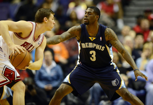 Oct 7, 2013; St. Louis, MO, USA; Memphis Grizzlies power forward Willie Reed (3) defends against Chicago Bulls power forward Erik Murphy (31) during the fourth quarter at Scottrade Center. Chicago defeated Memphis 106-87. Mandatory Credit: Jeff Curry-USA TODAY Sports