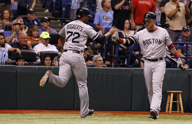 Oct 7, 2013; St. Petersburg, FL, USA; Boston Red Sox shortstop Xander Bogaerts (72) is congratulated by left fielder Mike Carp (37) after he scored a run during the ninth inning against the Tampa Bay Rays of game three of the American League divisional series at Tropicana Field. The Rays won 5-4. Mandatory Credit: Kim Klement-USA TODAY Sports