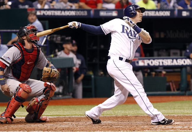 Oct 7, 2013; St. Petersburg, FL, USA; Tampa Bay Rays catcher Jose Lobaton (59) hits a walk off solo home run during the ninth inning against the Boston Red Sox of game three of the American League divisional series at Tropicana Field. The Rays won 5-4. Mandatory Credit: Kim Klement-USA TODAY Sports