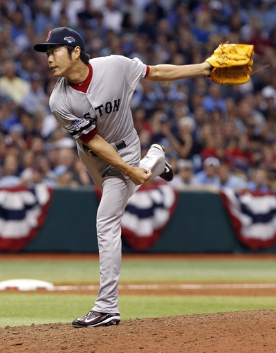 Oct 7, 2013; St. Petersburg, FL, USA; Boston Red Sox relief pitcher Koji Uehara (19) throws a pitch during the ninth inning against the Tampa Bay Rays of game three of the American League divisional series at Tropicana Field. The Rays won 5-4. Mandatory Credit: Kim Klement-USA TODAY Sports
