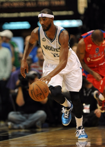 Oct 7, 2013; Minneapolis, MN, USA;  Minnesota Timberwolves forward Corey Brewer (13) brings the ball up court in the third quarter against the CSKA Moscow at Target Center.  CSKA Moscow defeated the Minnesota Timberwolves 108-106 in overtime.  Mandatory Credit: Marilyn Indahl-USA TODAY Sports