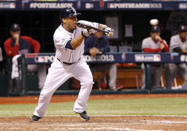 Oct 7, 2013; St. Petersburg, FL, USA; Tampa Bay Rays center fielder Desmond Jennings (8) bunts during the eighth inning against the Boston Red Sox in game three of the American League divisional series at Tropicana Field. The Rays won 5-4. Mandatory Credit: Kim Klement-USA TODAY Sports