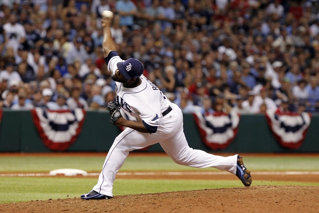 Oct 7, 2013; St. Petersburg, FL, USA; Tampa Bay Rays relief pitcher Fernando Rodney (56) throws a pitch during the ninth inning against the Boston Red Sox  in game three of the American League divisional series at Tropicana Field. The Rays won 5-4. Mandatory Credit: Kim Klement-USA TODAY Sports
