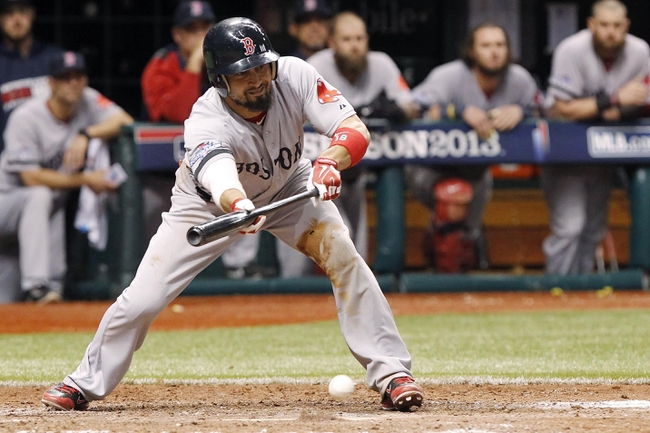 Oct 7, 2013; St. Petersburg, FL, USA; Boston Red Sox right fielder Shane Victorino (18) bunts during the ninth inning against the Tampa Bay Rays in game three of the American League divisional series at Tropicana Field. The Rays won 5-4. Mandatory Credit: Kim Klement-USA TODAY Sports