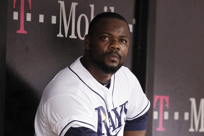 Oct 7, 2013; St. Petersburg, FL, USA; Tampa Bay Rays relief pitcher Fernando Rodney (56) reacts in the dugout after pitching the ninth inning against the Boston Red Sox in game three of the American League divisional series at Tropicana Field. The Rays won 5-4. Mandatory Credit: Kim Klement-USA TODAY Sports