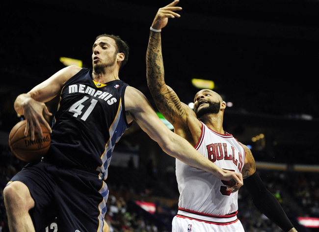 Oct 7, 2013; St. Louis, MO, USA; Memphis Grizzlies center Kosta Koufos (41) rebounds against Chicago Bulls power forward Carlos Boozer (5) during the third quarter at Scottrade Center. Chicago defeated Memphis 106-87. Mandatory Credit: Jeff Curry-USA TODAY Sports