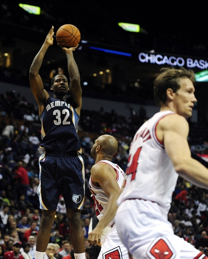 Oct 7, 2013; St. Louis, MO, USA; Memphis Grizzlies power forward Ed Davis (32) shoots against the Chicago Bulls during the fourth quarter at Scottrade Center. Chicago defeated Memphis 106-87. Mandatory Credit: Jeff Curry-USA TODAY Sports