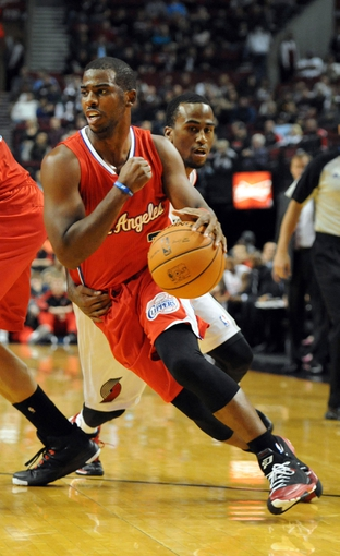 Oct 7, 2013; Portland, OR, USA; Los Angeles Clippers point guard Chris Paul (3) drives to the basket on Portland Trail Blazers point guard Dee Bost (4) during the first quarter of the game at Moda Center. Mandatory Credit: Steve Dykes-USA TODAY Sports