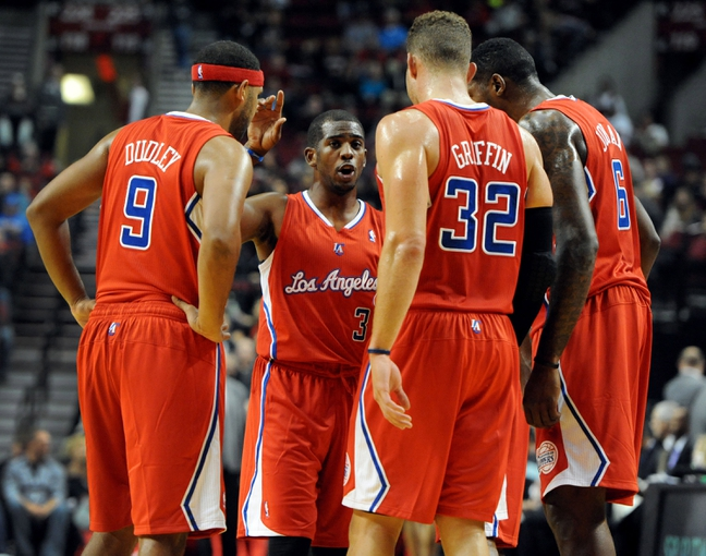 Oct 7, 2013; Portland, OR, USA;  Los Angeles Clippers point guard Chris Paul (3) speaks with his teammates,  shooting guard Jared Dudley (9), power forward Blake Griffin (32) and center DeAndre Jordan (6) during the first quarter of the game against the Portland Trail Blazers at Moda Center. Mandatory Credit: Steve Dykes-USA TODAY Sports