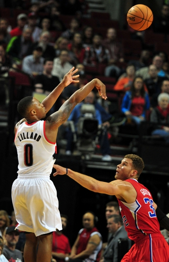 Oct 7, 2013; Portland, OR, USA; Portland Trail Blazers point guard Damian Lillard (0) shoots the ball over Los Angeles Clippers power forward Blake Griffin (32) during the first quarter of the game at Moda Center. Mandatory Credit: Steve Dykes-USA TODAY Sports