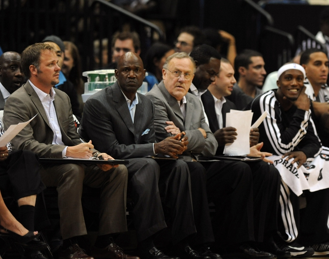 Oct 7, 2013; Minneapolis, MN, USA;  Minnesota Timberwolves head coach Rick Adelman (center) and assistant coaches in the third quarter against the CSKA Moscow at Target Center.  CSKA Moscow defeated the Minnesota Timberwolves 108-106 in overtime.  Mandatory Credit: Marilyn Indahl-USA TODAY Sports
