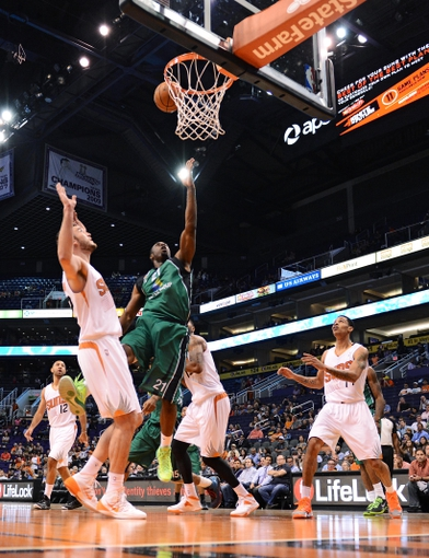 Oct 7, 2013; Phoenix, AZ, USA; Haifa  forward Ike Ofoegbu (21) lays up the ball against the Phoenix Suns forward Miles Plumlee (22) in the first half at US Airways Center. Mandatory Credit: Jennifer Stewart-USA TODAY Sports