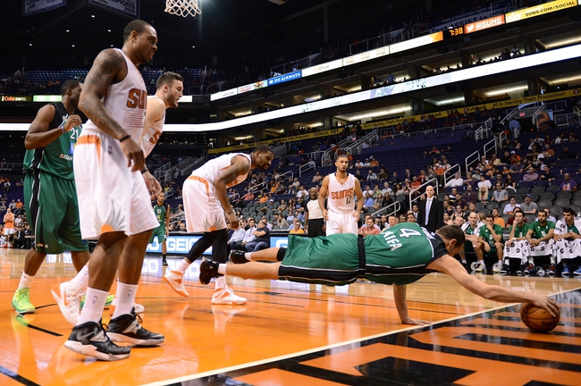 Oct 7, 2013; Phoenix, AZ, USA; Haifa  center Uri Kokia (4) dives for the ball in the first half as the Phoenix Suns watch on at US Airways Center. Mandatory Credit: Jennifer Stewart-USA TODAY Sports