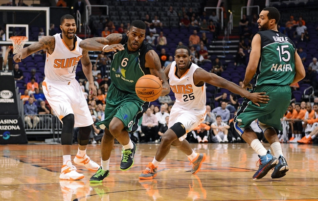 Oct 7, 2013; Phoenix, AZ, USA; Haifa  forward Donta Smith (6) makes a steal in the first half against the Phoenix Suns forward Markieff Morris (11) and guard Dionte Christmas (25) at US Airways Center. Mandatory Credit: Jennifer Stewart-USA TODAY Sports