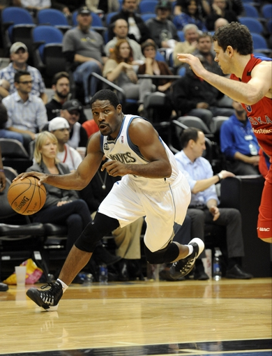 Oct 7, 2013; Minneapolis, MN, USA;  Minnesota Timberwolves guard Othyus Jeffers (12) drives to the basket in the third quarter against the CSKA Moscow at Target Center.  CSKA Moscow defeated the Minnesota Timberwolves 108-106 in overtime.  Mandatory Credit: Marilyn Indahl-USA TODAY Sports