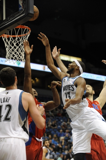 Oct 7, 2013; Minneapolis, MN, USA;  Minnesota Timberwolves guard Kevin Martin (23) takes a shot in the third quarter against the CSKA Moscow at Target Center.  CSKA Moscow defeated the Minnesota Timberwolves 108-106 in overtime.  Mandatory Credit: Marilyn Indahl-USA TODAY Sports