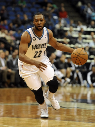 Oct 7, 2013; Minneapolis, MN, USA;  Minnesota Timberwolves guard A.J. Price (22) brings the ball up court in the third quarter against the CSKA Moscow at Target Center.  CSKA Moscow defeated the Minnesota Timberwolves 108-106 in overtime.  Mandatory Credit: Marilyn Indahl-USA TODAY Sports