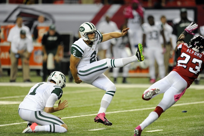 Oct 7, 2013; Atlanta, GA, USA; New York Jets place kicker Nick Folk (2) kicks the game winning field goal against the Atlanta Falcons during the fourth quarter at the Georgia Dome. The Jets defeated the Falcons 30-28. Mandatory Credit: Dale Zanine-USA TODAY Sports