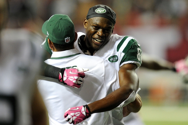 Oct 7, 2013; Atlanta, GA, USA; New York Jets wide receiver Stephen Hill (84) reacts with a coach after the Jets defeated the Atlanta Falcons at the Georgia Dome. The Jets defeated the Falcons 30-28. Mandatory Credit: Dale Zanine-USA TODAY Sports