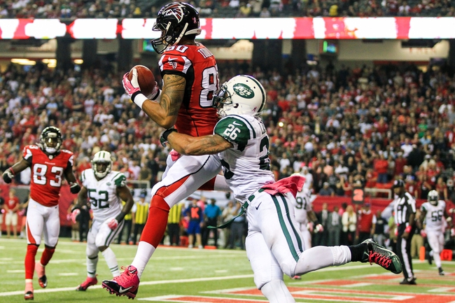 Oct 7, 2013; Atlanta, GA, USA; Atlanta Falcons tight end Levine Toilolo (80) catches a touchdown pass over New York Jets safety Dawan Landry (26) in the second half at the Georgia Dome. The Jets won 30-28. Mandatory Credit: Daniel Shirey-USA TODAY Sports