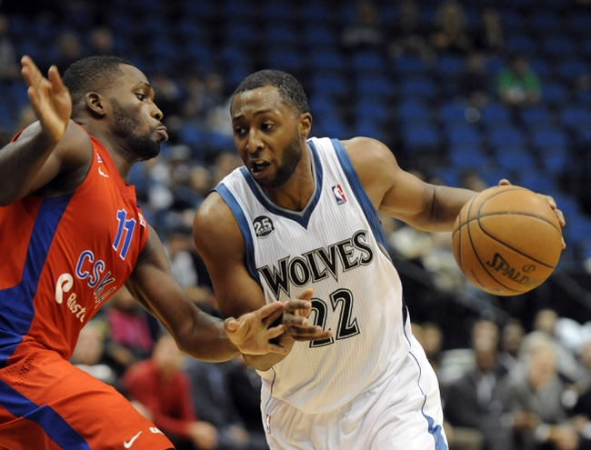 Oct 7, 2013; Minneapolis, MN, USA;  Minnesota Timberwolves guard A. J. Price (22) drives to the basket in the fourth quarter against the CSKA Moscow at Target Center.  CSKA Moscow defeated the Minnesota Timberwolves 108-106 in overtime.  Mandatory Credit: Marilyn Indahl-USA TODAY Sports