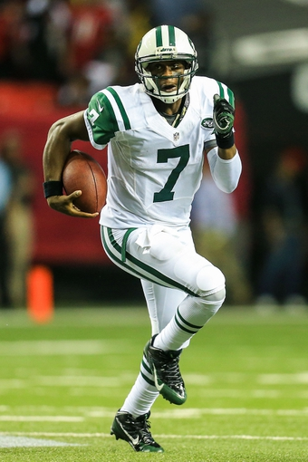 Oct 7, 2013; Atlanta, GA, USA; New York Jets quarterback Geno Smith (7) runs the ball in the second half against the Atlanta Falcons at the Georgia Dome. The Jets won 30-28. Mandatory Credit: Daniel Shirey-USA TODAY Sports