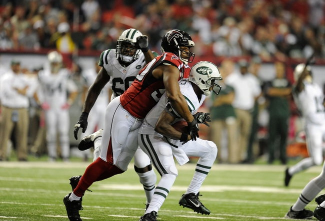 Oct 7, 2013; Atlanta, GA, USA; Atlanta Falcons defensive end Osi Umenyiora (50) sacks New York Jets quarterback Geno Smith (7) during the second half at the Georgia Dome. The Jets defeated the Falcons 30-28. Mandatory Credit: Dale Zanine-USA TODAY Sports