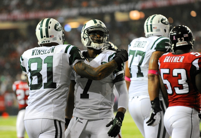 Oct 7, 2013; Atlanta, GA, USA; New York Jets tight end Kellen Winslow (81) and quarterback Geno Smith (7) react after connecting on a touchdown during the second half at the Georgia Dome. The Jets defeated the Falcons 30-28. Mandatory Credit: Dale Zanine-USA TODAY Sports