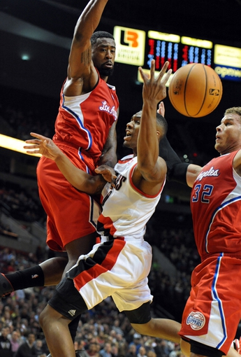 Oct 7, 2013; Portland, OR, USA; Portland Trail Blazers point guard Damian Lillard (0) runs into Los Angeles Clippers center DeAndre Jordan (6) and power forward Blake Griffin (32) as he drives to the basket during the third quarter of the game at Moda Center. Mandatory Credit: Steve Dykes-USA TODAY Sports