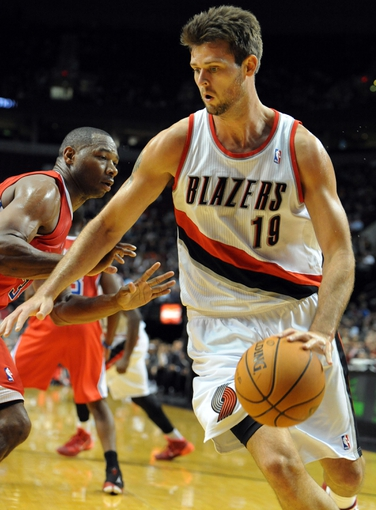 Oct 7, 2013; Portland, OR, USA; Portland Trail Blazers power forward Joel Freeland (19) drives to the basket on Los Angeles Clippers shooting guard Willie Green (34) during the third quarter of the game at Moda Center. Mandatory Credit: Steve Dykes-USA TODAY Sports