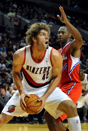 Oct 7, 2013; Portland, OR, USA; Portland Trail Blazers center Robin Lopez (42) drives to the basket on Los Angeles Clippers shooting guard Willie Green (34) during the third quarter of the game at Moda Center. Mandatory Credit: Steve Dykes-USA TODAY Sports