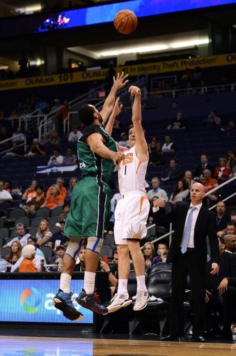 Oct 7, 2013; Phoenix, AZ, USA; Phoenix Suns guard Goran Dragic (1) puts up a shot in the second half against Haifa forward Brian Randle (15) at US Airways Center. The Suns defeated Haifa 130 to 89.  Mandatory Credit: Jennifer Stewart-USA TODAY Sports