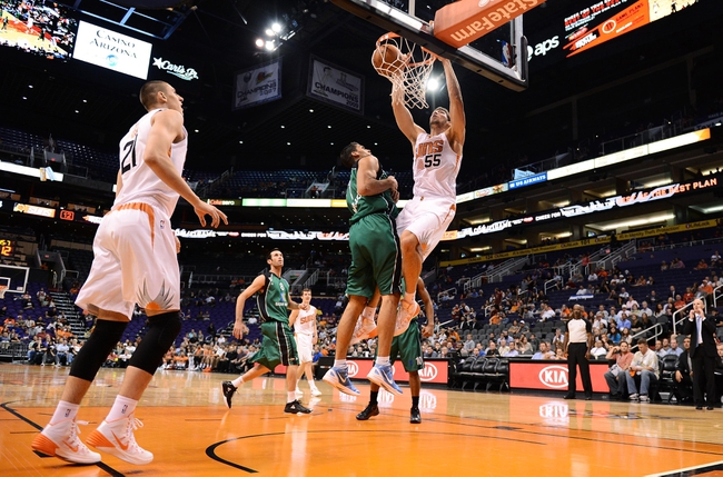 Oct 7, 2013; Phoenix, AZ, USA; Phoenix Suns center Viacheslav Kravtsov (55)  dunks the ball over Haifa center Alex Chubrevich (7) in the second half at US Airways Center. The Suns defeated Haifa 130 to 89.  Mandatory Credit: Jennifer Stewart-USA TODAY Sports
