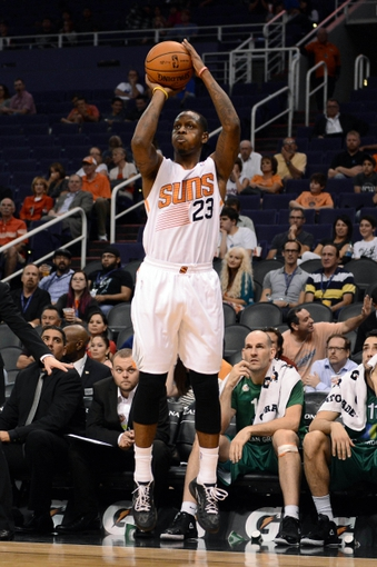 Oct 7, 2013; Phoenix, AZ, USA; Phoenix Suns forward James Nunnally (23) puts up a shot in the second half against Haifa at US Airways Center. The Suns defeated Haifa 130 to 89.  Mandatory Credit: Jennifer Stewart-USA TODAY Sports