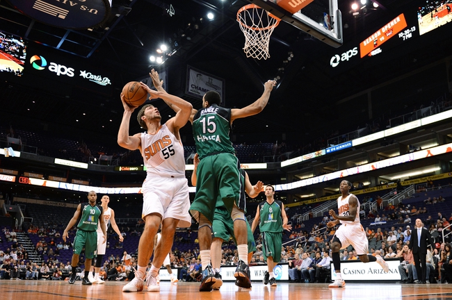 Oct 7, 2013; Phoenix, AZ, USA; Phoenix Suns center Viacheslav Kravtsov (55) is guarded by Haifa forward Brian Randle (15) in the second half at US Airways Center. The Suns defeated Haifa 130 to 89.  Mandatory Credit: Jennifer Stewart-USA TODAY Sports
